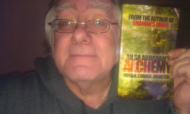 """Happy Reader Chris who left this review and was the 1st to post """"me with book"""" photo."""